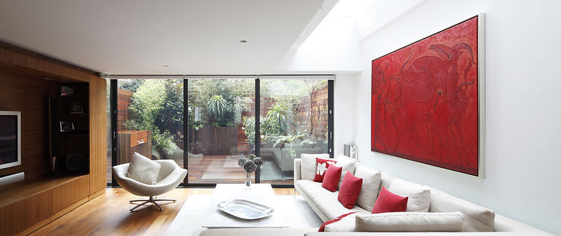 Contemporary living room with glazed doors to garden (lights off)